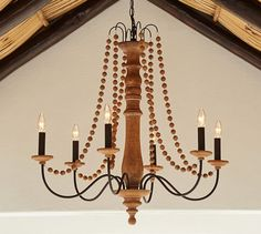 ties in with cabinets.  Evelyn Indoor/Outdoor Wood Chandelier | Pottery Barn