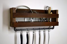 [ D E S C R I P T I O N ] Add a touch of country style to your kitchen. This pot and lid rack mounts to the wall freeing up cabinet space. A 24 cast iron bar is firmly attached to the bottom with 6 hooks to conveniently hang pots, pans, and utensils you use most. -------------------------------------------------- [ F I N I S H / C O L O R ] Light Walnut  -------------------------------------------------- [ D I M E N S I O N S ] 29 Width x 10 Height x 6 Depth Overall height including bar ...