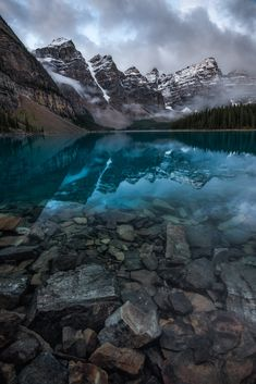 Something hopefully a little different (yes, these rocks are underwater!) from Moraine Lake, Banff (OC)[1335x2000]