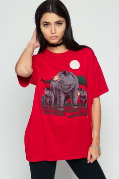 Vintage 80s t shirt in red with a momma and baby bear print. Unisex.  Every item we sell is authentic vintage and one-of-a-kind! You will receive the EXACT item shown in the photos. For reference, model is 57 and measures 32-24-34. DETAILS  Best fits: Labeled Large (Note: We only have ONE in stock. If more than one size is listed it is because this item will work on a range of sizes. Check measurements for exact fit.) Condition: Great Vintage Material: Lightweight Cotton/poly blend  MEAS...