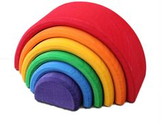 The tiny colourful wooden stacking rainbow is a great versatile toy, representing the element of air. The rainbow tunnel can be used as a bridge, tunnel, fence or a tiny house. A single piece can also be used as a seesaw. A fantastic small toy which also looks great on the shelf in the nursery.