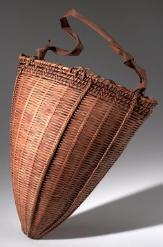 Africa | Fish carrying basket 'edibili' from the Mangbetu people of Medje, Congo (Belgian Congo) | Plant fiber and wood | ca. 1915 | These baskets were made by men, used by both sexes to carry all sorts of things, but they are made for the specific purposes of taking fish.