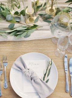 "Modern olive branch and grey wedding table decor: <a href=""http://www.stylemepretty.com/little-black-book-blog/2017/01/16/romantic-malibu-wedding-on-a-hilltop/"" rel=""nofollow"" target=""_blank"">www.stylemepretty...</a> Photography: Kurt Boomer - <a href=""http://www.kurtboomer.com/"" rel=""nofollow"" target=""_blank"">www.kurtboomer.com/</a>"