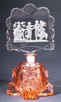 A perfume bottle, circa 1920s, in pink and clear crystal, with dauber. Stenciled circle MADE IN CZECHOSLOVAKIA