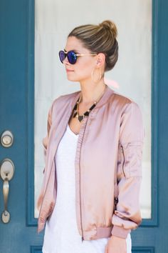 Everyone needs a classic bomber jacket in their closet and we think this one is calling your name. This long sleeve, satin beauty is a favorite among the SB family with it's zipper and extra pocket de