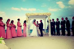 #beachsideceremony #arch #flowers #love #wedding #vows #rings #beach #ocean #miami #florida #destination #bride