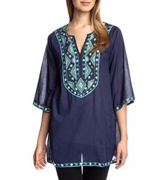 "Leilana is a KAS classic. A tunic with eye-catching hand embroidery along the neckline and side pockets. This is great for spring when paired with jeans and sandals!   -Split neck - 3/4 length sleeves - Stitch embroirdery trim - Side pleats - Approx 31"" length   Fiber Content: 100% Cotton   Care: Hand wash cold"