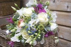 Bridesmaid bouquet of Avalanche Roses, pale blue Delphiniums, pink Clematis, Vuvuzela Roses, and seasonal herbs, designed and created by Hannah Berry Flowers www.hannahberryflowers.co.uk