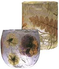 Glowing Flowers  When you press flowers and leaves, they become thinner and light can shine through them. In this project, you simply decoupage pressed flowers and leaves to a votive cup and cover with tissue paper.