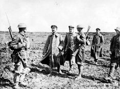 WWI: The Canadians captured more than 4,000 Germans during the Battle of Vimy Ridge. In this photograph, the soldiers in the soft caps are German officers, and perhaps senior enough to warrant the attention of the official Canadian photographer. CWM 19920085-924