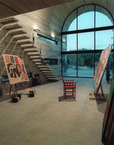 High-ceilinged modern studio.