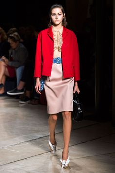Miuccia Prada is nothing if not efficient, and she has proven that she's a genius in the way she operates. Up close, her Miu Miu collection was a smorgasbord of frills, pencil skirts, coats, ruffles, plaid, color and texture. But when you pull back, like looking at it all on a contact sheet, you notice that she's so precisely consistent with her silhouette—a soft hourglass with a defined waist, all polished with an eclectic (read: kooky) ladylike styling. Imaxtree  - HarpersBAZAAR.com