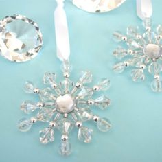 """Beaded Snowflake Ornaments by Event Blossom. $3.99. An """"ornament"""" is defined as an accessory used to beautify the appearance of an object. These breathtaking beaded snowflake ornaments can be used in a variety of ways, all winter long - to decorate a tree, on a door knob, hung from a rear view mirror, etc. These sparkling ornaments with their ice like beauty will be enjoyed by guests for years to come. Crafted entirely by hand and made from a combination of clear and silver be..."""
