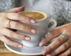 Blogger @katelavie_ enjoying a delicious cup of coffee wearing her favorite rings from PANDORA's Autumn collection 2015. #PANDORAring