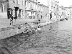 Life on the canal.  This was back when one could swim in the #Venice canals.