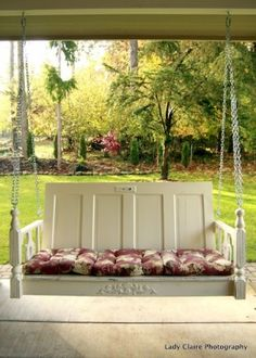 Isn't this the most perfect repurposed porch swing ever?? Made from an old door, tabletop and table legs....what a perfect spot to relax!!