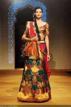 A model flaunts a creation by designers Ashima and Leena on Day 4 of the India Bridal Fashion Week (IBFW) 2013 at The Grand, Vasant Kunj in New Delhi