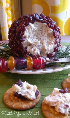 Christmas Cranberry Cheese Ball! A festive cheese ball made with goat cheese or cream cheese, white cheddar, pecans and cranberries.