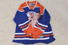 We just had a beautiful boy born January 16, 2014. My boyfriend is a huge fan of the #Oilers, so we wanted to get a special picture of our litte guy at only 17 days old cheering on his new favourite team! - Courtney Brands