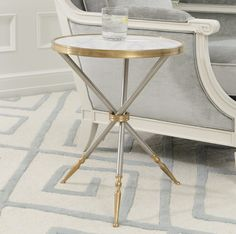 This wonderful table has cast brass fittings and sabots with brushed steel legs and frame. A cast brass filet surrounds the white, honed marble tabletop. This piece is an updated take on traditional Campaign style furniture. Campaign furniture is symbolic for style made for travel; historically, much of it was made for military campaigns. 17″Dia. x 21″H