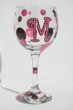 Decorated Wine glasses. I need to get some glass paint. This would be fun to make!