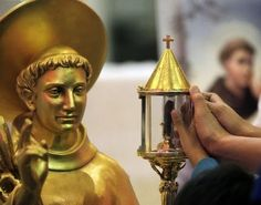 Image result for St Anthony of Padua with light in hand
