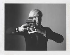 Andy Warhol with a Polaroid SX-70
