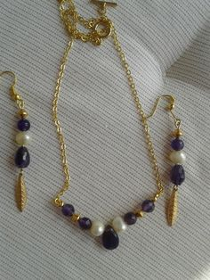 Amethyst and freshwater pearl with gold necklace and earring set.
