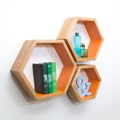 This set of three hexagon shelves is the perfect blend of funky & functional! And the best part? The shelves fit inside of each other to reduce the cost of shipping! These unique shelves are created by hand, finished to your specifications and packaged with care - every set is an original work of art! Each shelf hangs individually, so you can arrange them in any configuration that works best for your decor. This listing is for a set of 3 individual Hexagons. If you need a different number of…