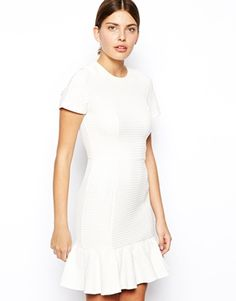 Textured dress in off white with peplum hem. I purchased this one yesterday, the ultimate wardrobe staple.