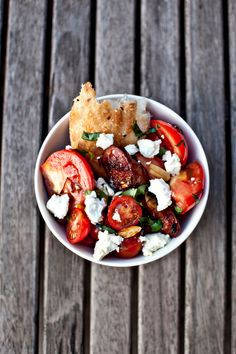 french bread, roasted tomatoes in balsamic vinegar, feta cheese, and fresh strips of basil with salt and pepper to taste.