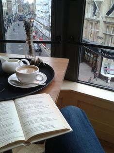 """papermanquotes: """"My reading spot today: W Cafe in Waterstones, Oxford. I'm reading Virgil's Eclogues. """""""