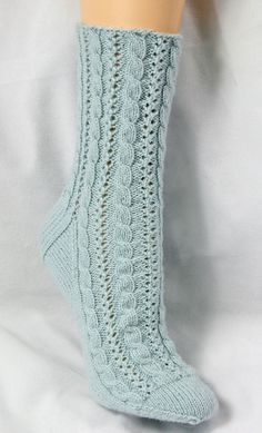 Knitting Patterns Mittens These fun socks combine two of my favorite techniques - cables and lace. Great to wear year-round!Ravelry: Cabled Lace Socks pattern by Chrissy Gardiner - 4 plyonline knitting pattern store - your source for paid and free knittin Love Knitting, Knitting Stitches, Knitting Socks, Knitting Patterns Free, Baby Knitting, Knitting Needles, Lace Socks, Crochet Socks, Crochet Lace