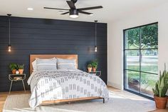 """HGTV on Instagram: """"On this week's Fixer Upper the former garage was transformed into an edgy master suite with modern design details like the black accent wall, a contemporary styled ceiling fan, updated lighting and simple, modern furnishings. And look at those windows! Click the link in bio to see more of this ultra-modern house."""""""