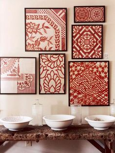frame an antique quilt, tablecloth, or other fabric --- love the diversity yet unity of the various designs in same color line