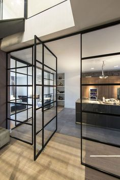Apartments Family Apartment in Amsterdam Flaunting Permanent Visual Connection Between Spaces: Amusing Of Interior Design Of Kitchen With Glass Door In Black Steel  Frame Also Flooring In Teak Wood Laminating Plus Great Pendant Light Plus Ceilling