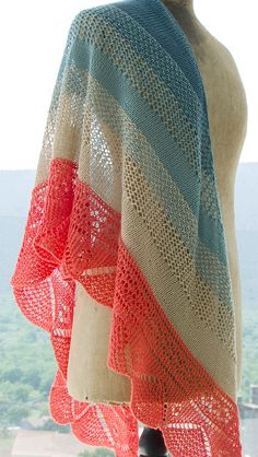 Free Knitting Pattern for Alfama Shawl - Large crescent shaped shawl knit sideways with alternating sections of stockinette and lace. Fingering weight yarn. Designed by Filipa Carneiro. Available in English and in Portuguese