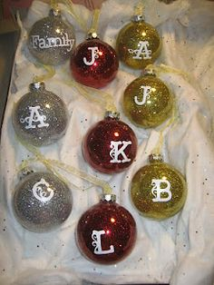 Plain glass christmas tree balls using pledge floor wax and glitter.  Used Cricut E2 to cut out the letters using vinyl.