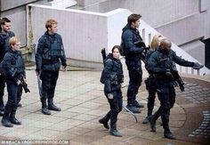 Anybody else notice how peeta is lolling at katniss in all of these set pictures?? My everlark feels