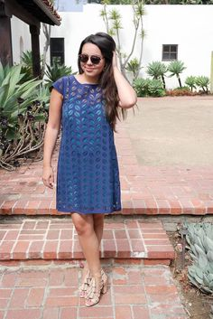 Love this laser cut dress! It's actually two pieces – a turquoise slip and the navy laser cut overlay. So flattering, and perfect for so many occasions! You could wear this to a family brunch, just for the day, or even for a night out!