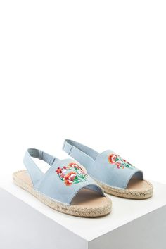 A pair of woven slingback sandals featuring an open toe, a floral embroidered vamp, and an espadrille platform.