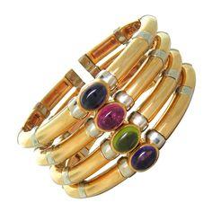 Massive Bulgari Gem Set Gold Bracelet | From a unique collection of vintage cuff bracelets at http://www.1stdibs.com/jewelry/bracelets/cuff-bracelets/