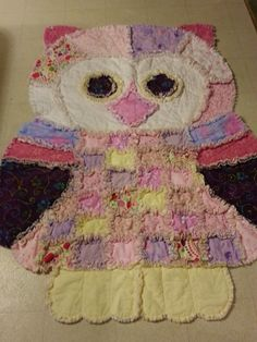 CustomMade by Ashley Alma: This is a cute owl-shaped rag quilt that I made for a baby shower.  The room was done in owls and the baby was a sweet little girl.  The rag quilt is made of flannel sandwiched with 80x20 warm