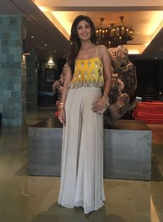 Shilpa Shetty at Bipasha Basu's Mehendi : Shilpa looked pretty in a yellow Arpita Mehta top with beige palazzoes. I like how simple, fuss-free yet dressy this look is.