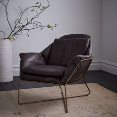 Beautifully architectural, the unique lines on our Origami Lounge Chair make it an understated statement piece. The hand-welded iron frame cradles a padded leather seat, with geometric folds inspired by its paper art namesake.