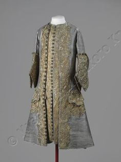 Waistcoat and frock coat worn by Emperor Peter II of Russia at his coronation in 1727. Probably made in France, fabric woven from silver wrapped silk thread, with silver-gilt and gold wrapped silk thread embroidery.