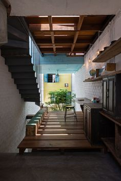 Saigon House by a21studio is filled with house-shaped rooms at different levels 21 December 2015