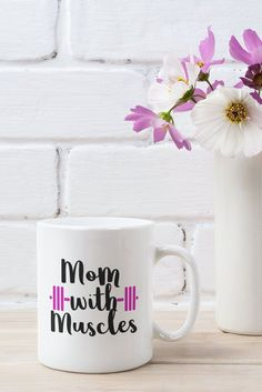 Mom with Muscles | Mom Strong | Strong Woman Mug | Gym Mug | Fitness Coffee Mug | Moms who Lift Add a bit of brightness to the morning routine with one of our high quality, dishwasher and microwave safe classic mugs made from quality ceramic with a comfortable handle.