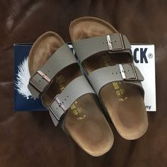 """Almost New Grey Birkenstocks Super cute Arizona Birkenstocks in the color """"stone""""! Only worn 2 times! They say size 9, but fit like 10's! Perfect for the upcoming spring season! Birkenstock Shoes Sandals"""