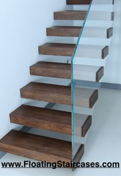 Floating Staircases In Dark Oak Finish With Opti White Glass Balustrade.  Design And Build By